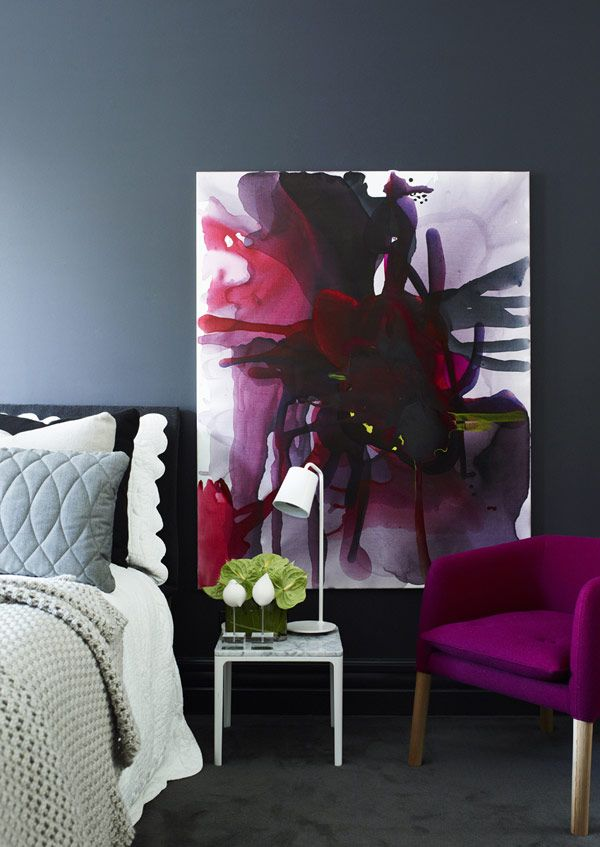 A great way to add vibrant colour in the bedroom - a large artwork and a chair in matching colours
