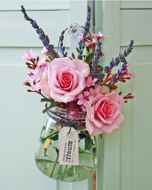 pink roses in old glass jar
