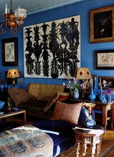 Blue wall with beige, brown, and white accented objects.