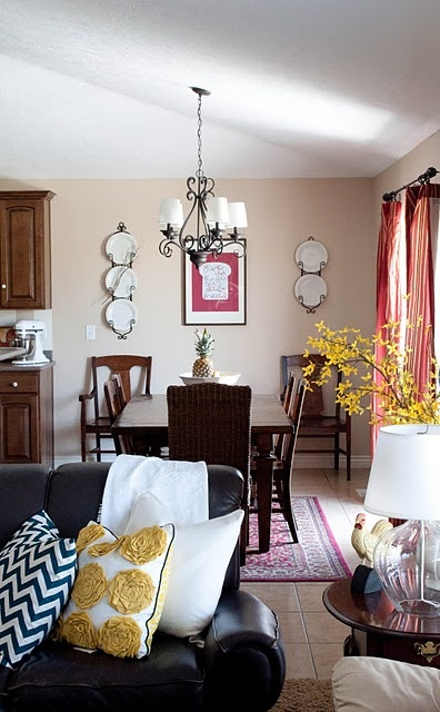 love the yellow and red with the dark couch and table