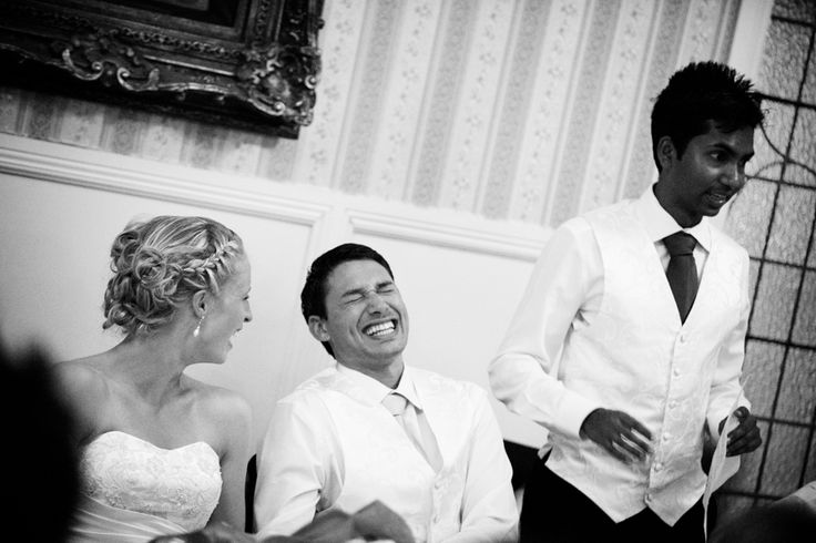 Groom laughs during best mans speech at Princes Gate Hotel, Rotorua. Black and white. Love Images creates beguiling fine art bridal images for the most discerning clients. We specialise in natural and relaxed photojournalistic wedding photography, supplying the most exclusive albums and prints from manufacturers such as Cypress Albums, Queensberry and Couture Book. We are a high end studio located in the beautiful city of Auckland, New Zealand.