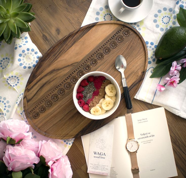 UNA SERVING TRAY IN WALNUT  Serving board Una is inspired by unity in compact elipse shape and traditional woodcarving decor. Una is an impressive tray for all kind of servings. Whether it be dinner or tea party, it's always a win-win.