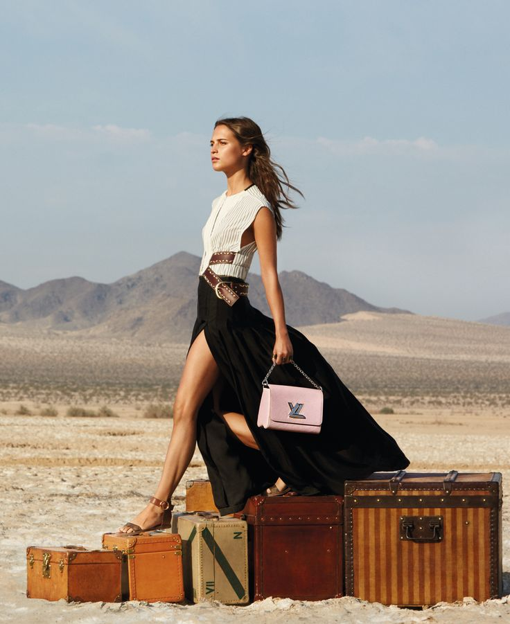 Alicia Vikander with a Twist handbag wearing a Louis Vuitton Cruise 2016 dress by Nicolas Ghesquiere for the Spirit Of Travel campaign by LouisVuitton in Palm Springs, California. Click through to discover the campaign