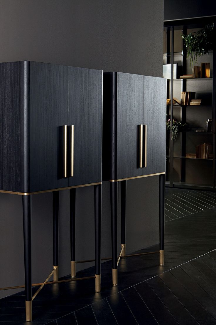 """Black (mod. Layer) lacquered ash wooden bar unit and satin brass details. Inside covered by engraved smoked """"grigio Italia"""" mirror. With light. 70 x.."""