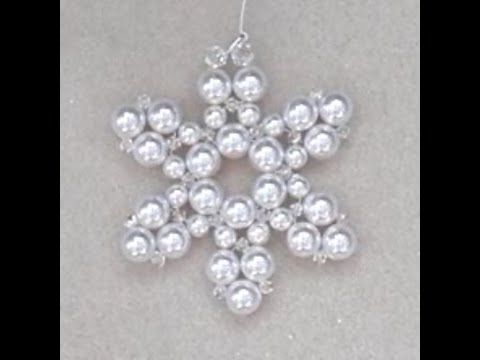 This sparkly Christmas decoration is made using non-tarnish silver plated wire and Swarovski crystals and pearls.