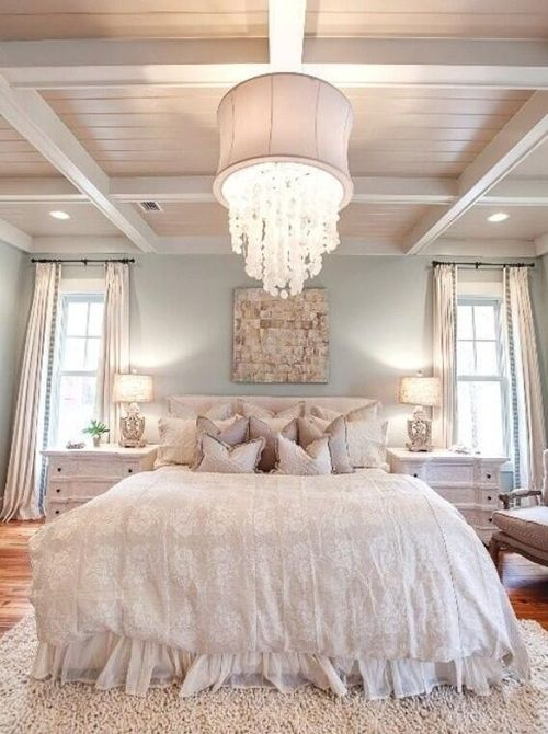 Beautiful room. Love the sea foam color walls, white bed spread, and chandelier. Clean look. Almost beachy.