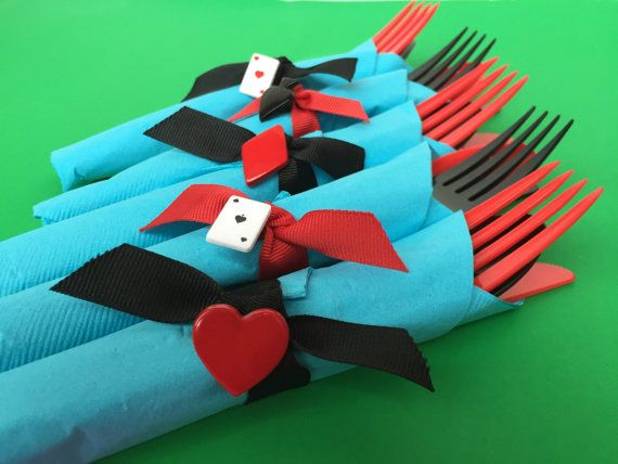 Mixed black and red disposable party silverware wrapped in a blue napkin with either a red or black ribbon finished with a Mad Hatter Tea Party charm napkin ring. Perfect for an Alice in Wonderland or a Mad Hatters Tea Party. You can select your flatware when you order - either a full set with knife fork and spoon or a dessert set with a fork and spoon. Please select the quantity you would like from the drop down menu - you may need to combine quantities to get the amount you would like, or…