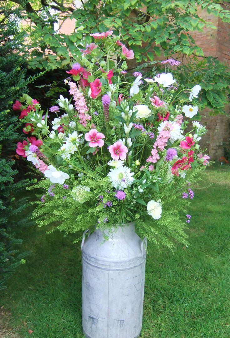 A country milk churn arrangement of seasonal summer flowers