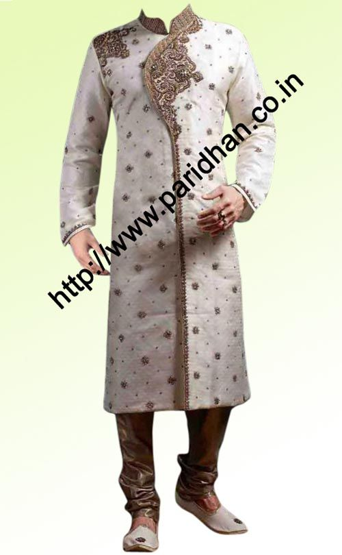 This type of embroidery for Dave with more crystal work.  Traditional embroidered nehru collar sherwani made from cream color dupion fabric. Hand embroidered as shown. It has bottom as chudidar made from dupion fabric in matching color. Dryclean only.