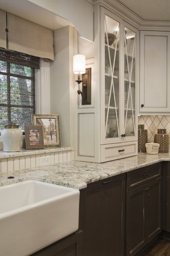Brown lower cabinets. Beautiful glass front full height cabinet Recent Projects traditional kitchen