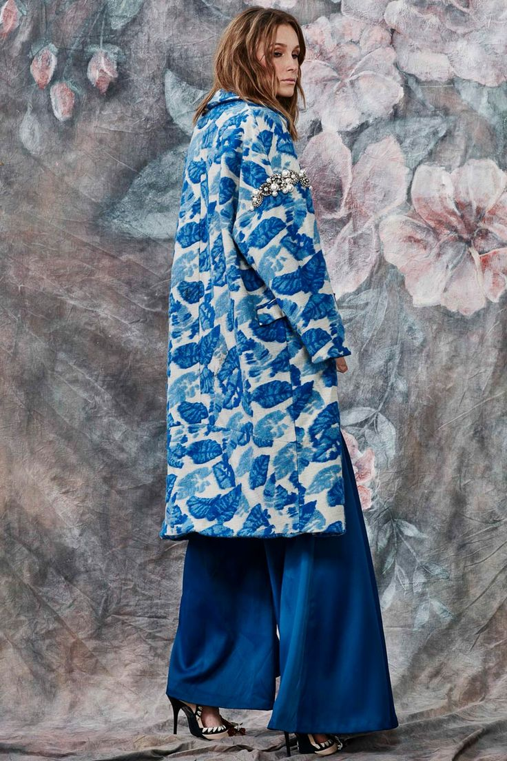 Cocoon yourself in a fabulous coat to instantly update your look. Delph blue abstract florals compliment the metallic threaded base of this coat. It has two pockets and two pearl buttons, as well as pearl and diamond detailing around both arms. Winter 2017 Size & Fit: Model is 177cm tall Model wears a NZ 8/ NZ S/ EU 36/ US 4 Wash Guide: Dry clean only. Select a high quality drycleaner. Gentle short cycle. Low moisture. Low temperature. Do not wring/drip dry. Do not...