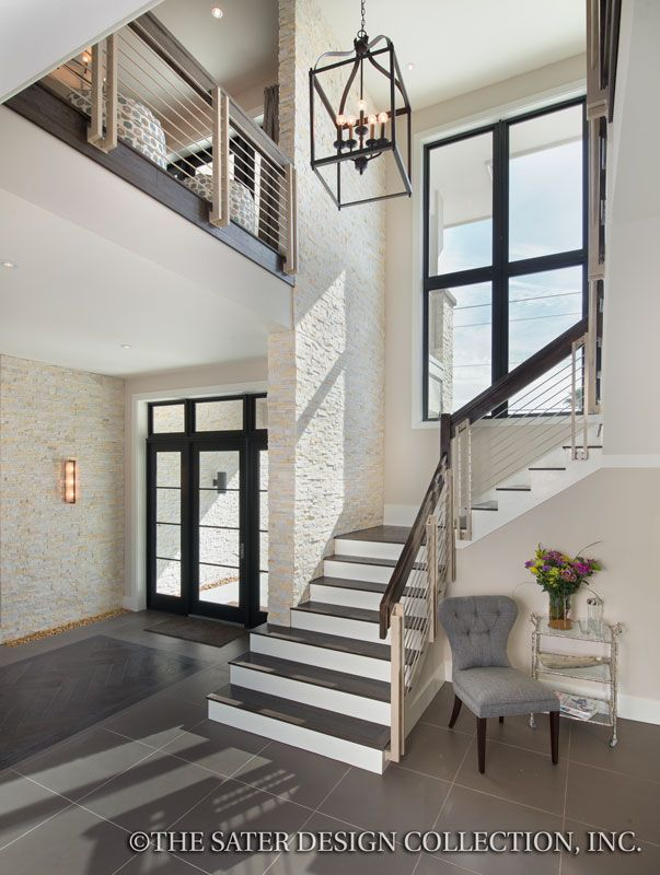 16 best images about great luxury home designs on for House plans with stairs in foyer