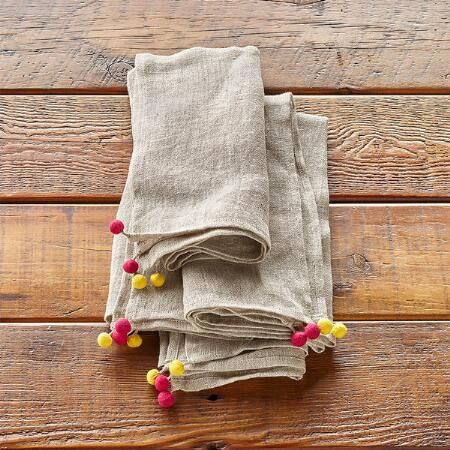 POMPOM LINEN NAPKINS, SET OF 4 - Handmade and hand woven exclusively for Sundance of linen with flirty, colorful cotton pompoms at the corners.