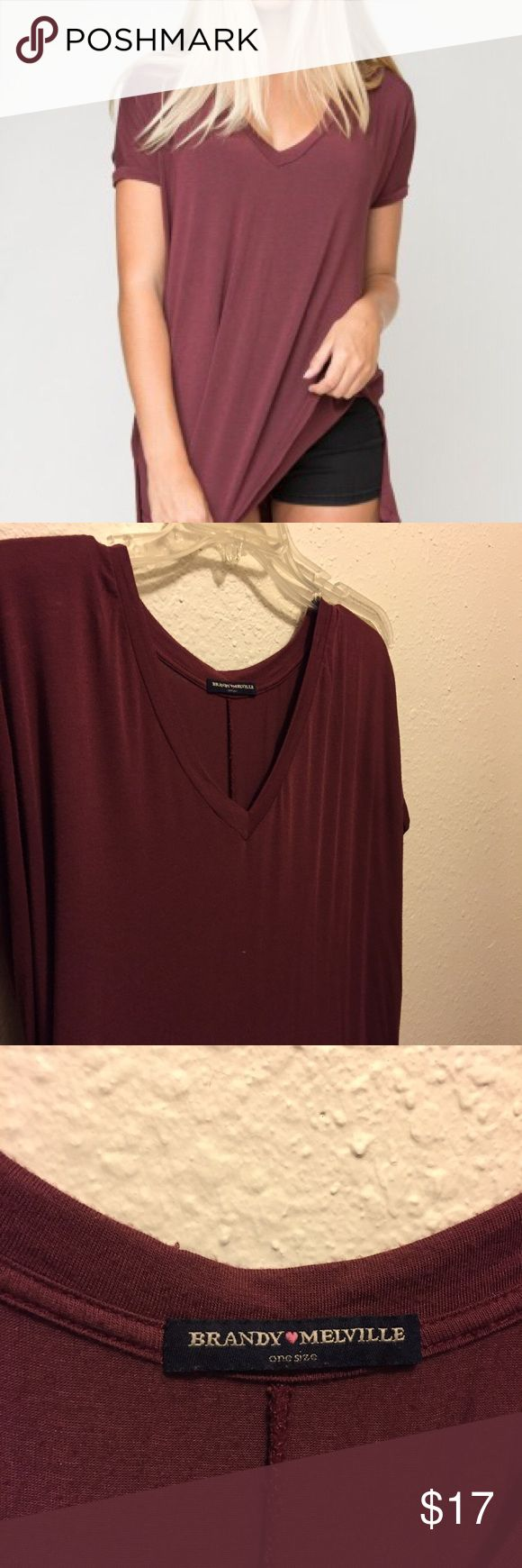 Brandy Melville Milan shirt BM Milan t shirt in burgundy. There's a little hole in the back and some weird stitching, but they're extremely unnoticeable when on. I love this but the arm holes are too small on me. Open to offers! Brandy Melville Tops Tees - Short Sleeve