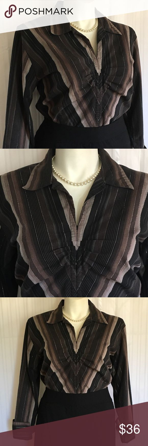 🎉JUST IN🎉 EUC Black & gray stripe stretch blouse 🎉JUST IN🎉 EUC Black & gray stripe stretch blouse/dress shirt with silver metallic pinstripes. Plus size 20 by Quizz Woman from Catherines. Measurements available upon request. 🚫No holds 🚫No Lowball Offers 🚫No Trades ✅Please submit reasonable offers via the offer button or 🎁 bundle & save! Catherines Tops Blouses