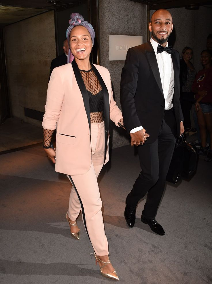 Alicia Keys escorted by her husband, the renowned producer, Swizz Beats at Tom Ford Fashion Show...