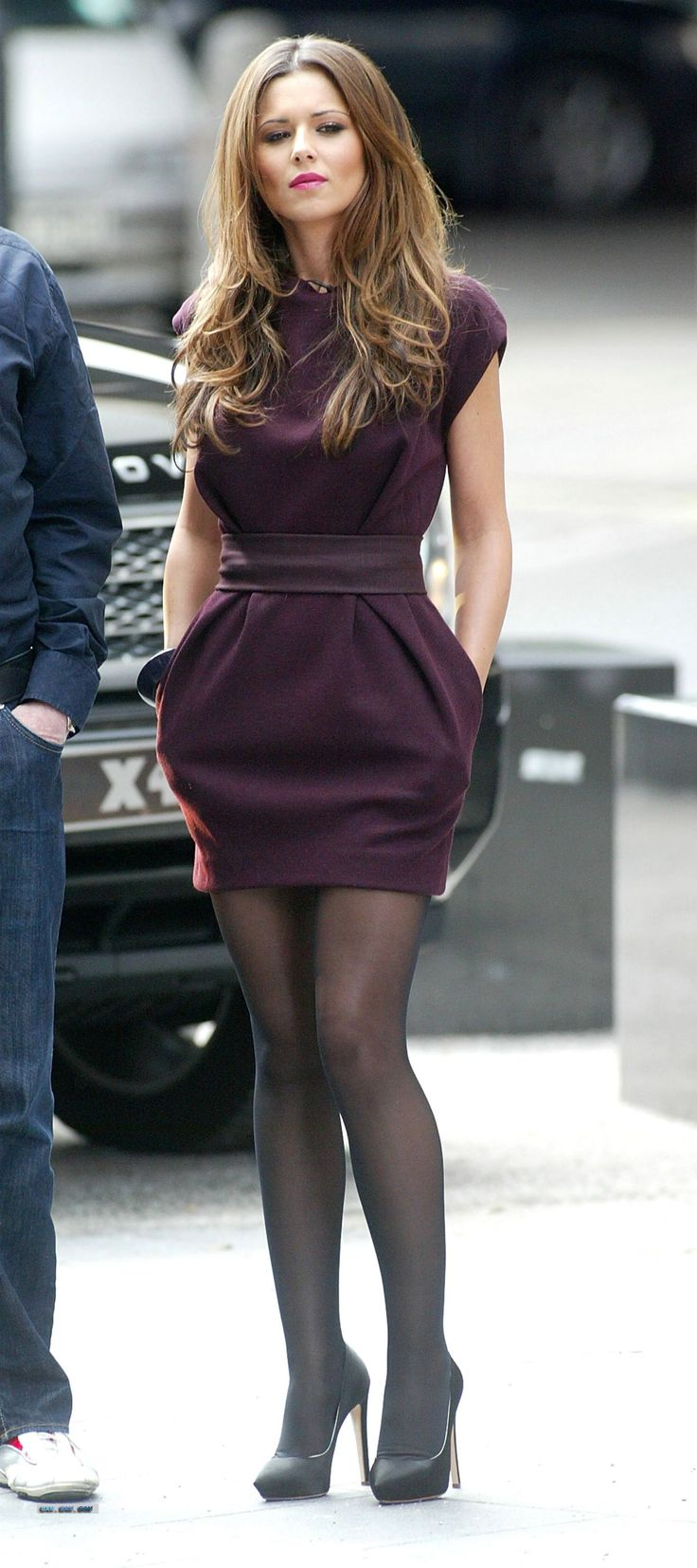 Cheryl Cole in plum dress and opaques.