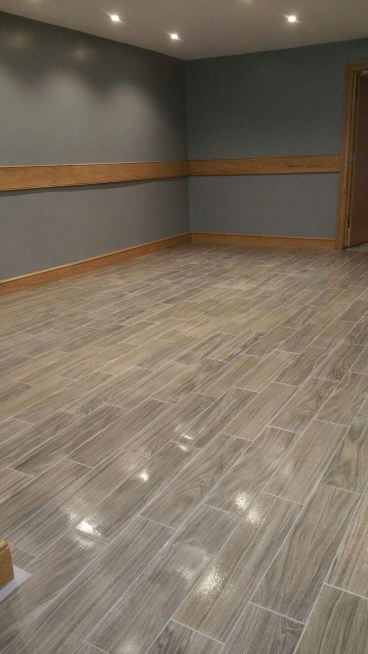 Wood effect floor tiling to indian restaurant www.surreyrefurbs.com