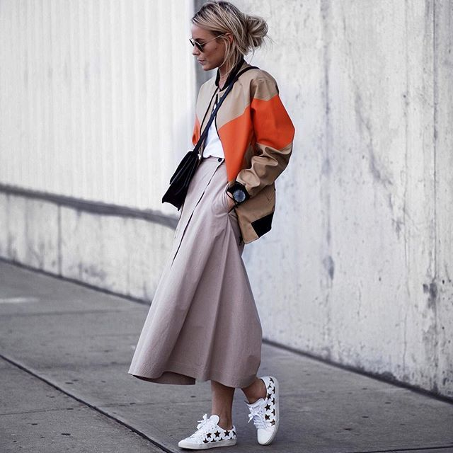 The Only #OOTDs From New York Fashion Week You Really Need to See A Button Skirt, Statement Sneakers, and a Striped Bomber Mary Seng of Happily Grey