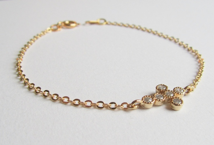 Sideways Cross Bracelets, Gold Cubic Zirconia detailed Cross Charm on a gold plated chain, Cross Bracelet. $26.00, via Etsy.
