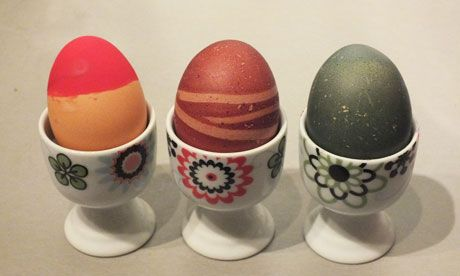 Egg decorating, three eggs in eggcups painted for Easter (From Guardian)