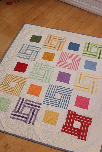 Colcha patchwork con rayas. Striped fabric squares quilt.
