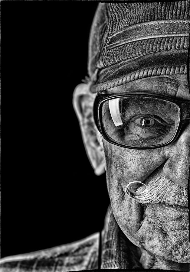 The wrinkles on his face only made him look like an old man. In his eyes though, you could tell there was something there. A young essence screaming to get out. And it did. When he talked, it was not the wise words of an old man that spoke, but the curious tone of a boy just learning of the world. -Description by Emma Lu