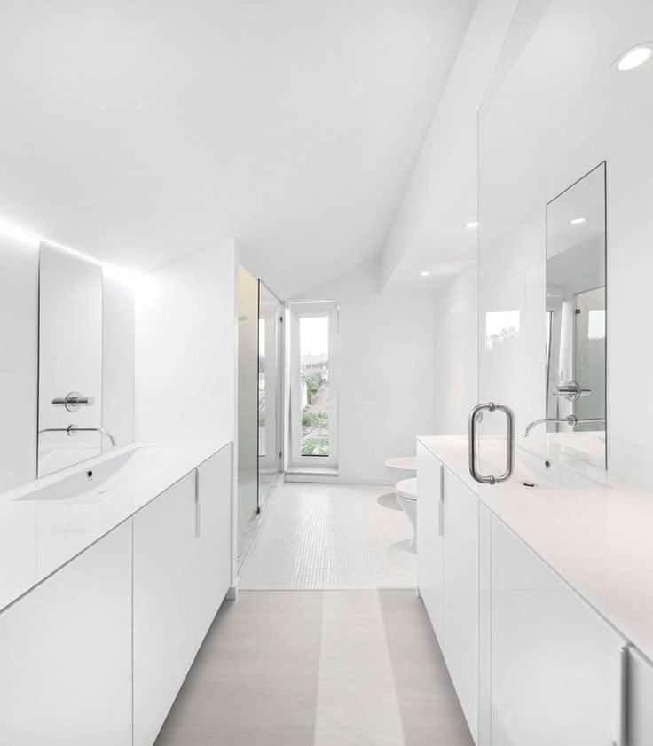 6 Ideas For Creating A Minimalist Bathroom // Stick To A Neutral Color Palette --- Use neutral colors, like white or grey, for the walls and scatter other neutral tones throughout the space as accents.