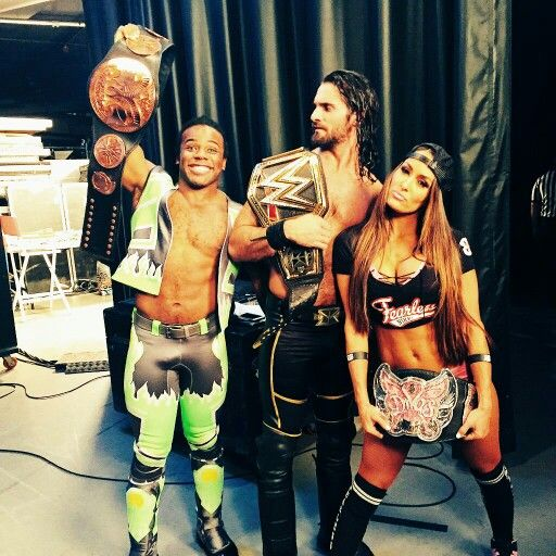 Xavier Woods, Seth Rollins, and Nikki Bella