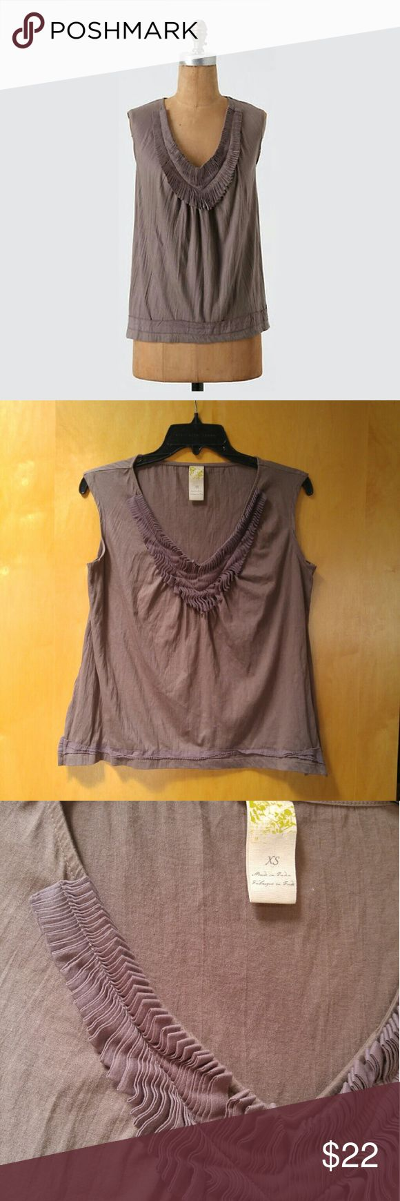 """Anthropologie C Keer Mane Event Tank C Keer brand from Anthropologie, size (XS) extra small, in excellent condition! Only has minor pilling from wear and wash. Color is a brownish, purplish, grayish. V-neck is adorned with folded ribbon. This unique sleeveless top could be easily dressed up or down! Has details on bottom hem and side slits. Measurements are 18"""" pit to pit and 22"""" length. May also fit a size (S) small. Cover photo from Anthro website. Please ask any questions. No trades. Make…"""