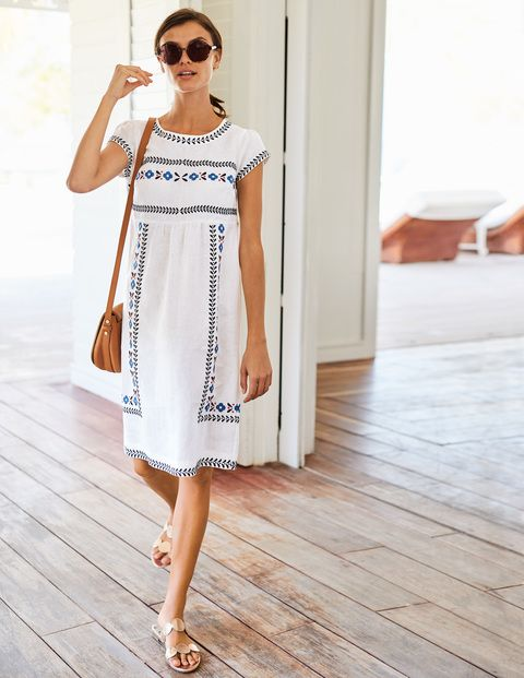When the sun (finally) makes an appearance, slip on this beautifully embroidered scoop-neck dress. An empire waist and gentle gathers front and back give it a relaxed shape, while the lightweight linen fabric will keep you cool in the face of rising temperatures (even if that's just on your commute).
