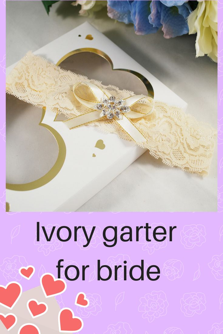 e990890ab26 Cream lace stretch garter on the bride s leg with a beautiful brooch and  satin bow