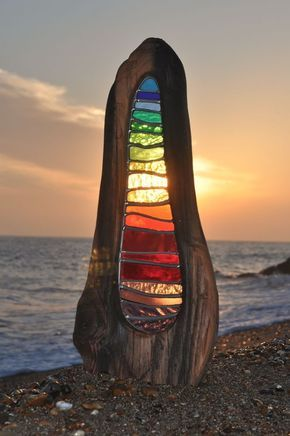 Glass Art Garden Sculptures ~ Louise Durham does beautiful work – stained glass sculptures with found wood.