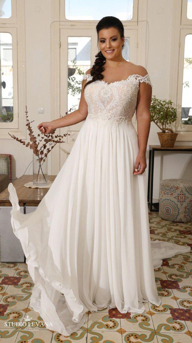 ea2214aec5b Plus size off shoulder bohemian wedding gown with unique lace embroidery.  Valentina. Studio Levana  uniquelaceweddingdresses