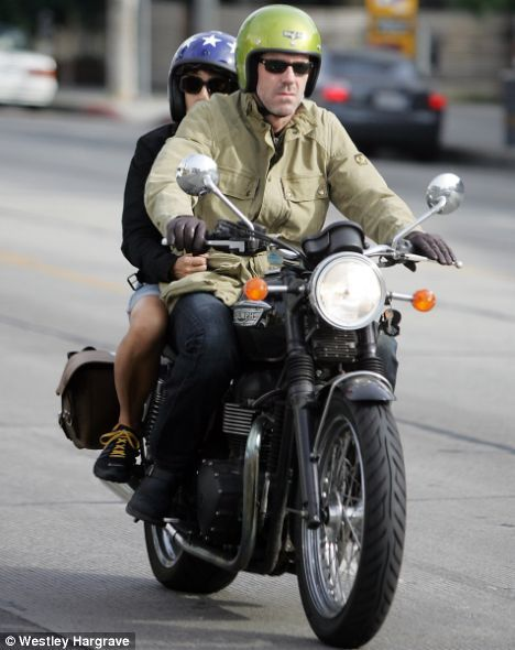 Oooh, Hugh Laurie on a Triumph T100