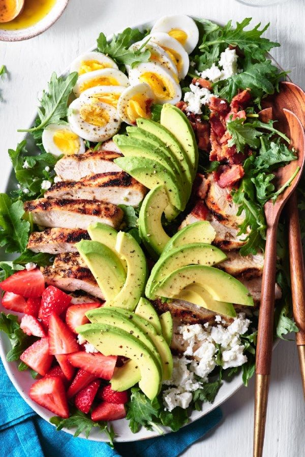 Try this satisfying salad recipe for an updated version of the classic Cobb. Kale, feta and strawberries give this chicken salad a colorful upgrade. #salads #saladrecipes #healthysalads #howtomakesalad #saladideas #recipe #eatingwell #healthy