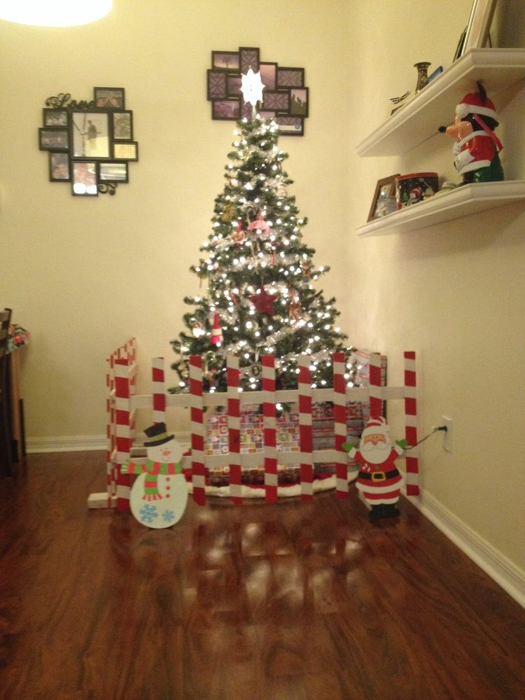 Toddler proofing Christmas tree weighed down and tied together fake - show me halloween pictures