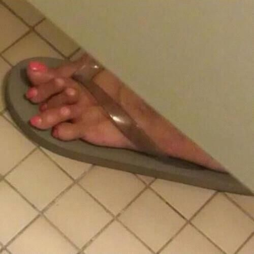 the best part of this picture is that someone was in a stall doing their business and saw this lady's foot and TOOK A PHOTO! hahaha