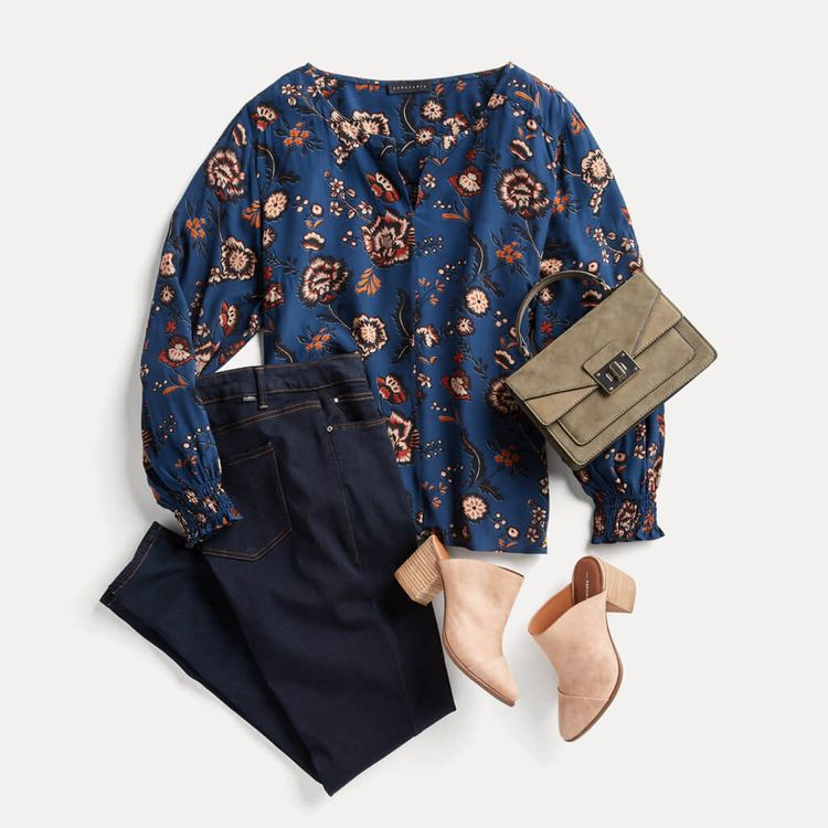 Love how feminine this top looks with a pair of dark blue jeans. Don't care for the shoes though.