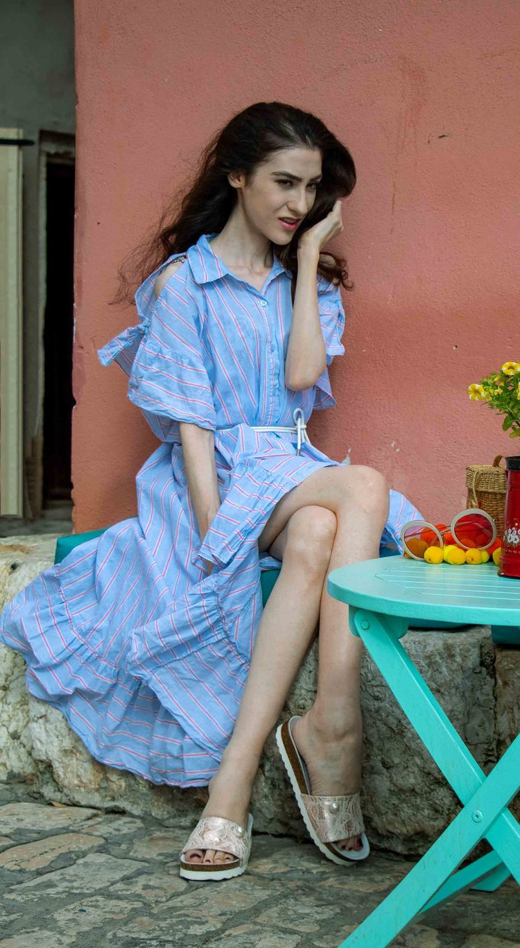 2112d0b73ad2 Fashion Blogger Veronika Lipar of Brunette from Wall Street dressed in  Storets cold shoulder striped ruffled summer dress