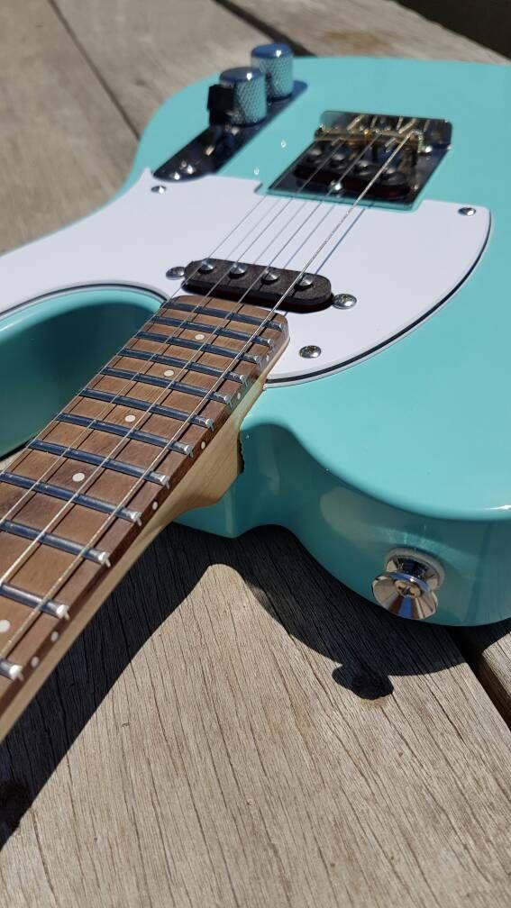 Pixelator - Bubblegum Blue electric ukulele  Custom made to