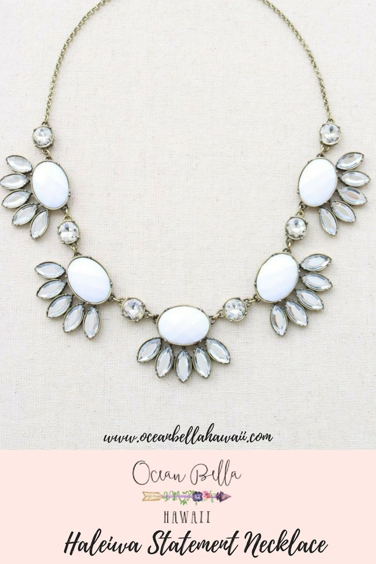 0a5d35786e7f5b Haleiwa Statement Necklace. Five elegant, white gems are skirted with clear  crystal leaves like fluttering lashes. Dress