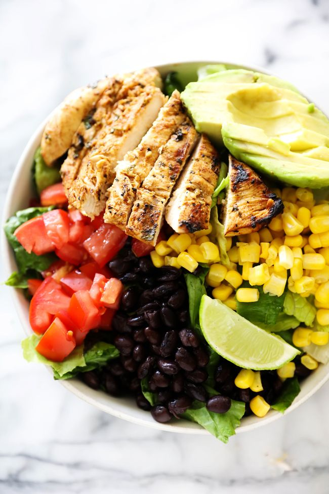 This Southwest Chicken Salad is loaded with black beans, corn, avocado, tomato, grilled southwest chicken and creamy tomatillo dressing.