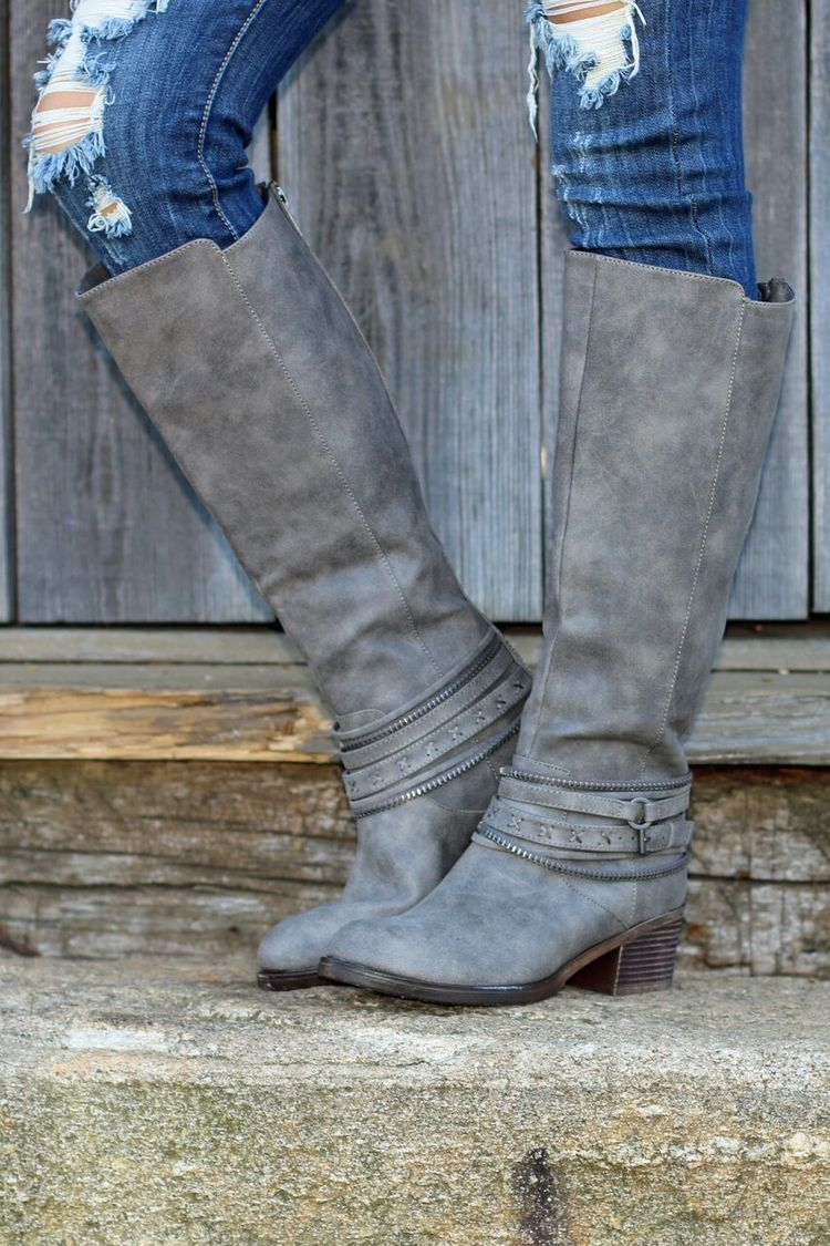 """If you like details, then you're going to LOVE these Time Of My Life Riding Boots! These grey leather riding boots have a weathered look, with seam detail and layered studded ankle straps to create an edgy look. - Fits true to size. - 2"""" heel. - Toe: Rounded - Closure: Zip up in back - Spot clean. - Manmade material."""