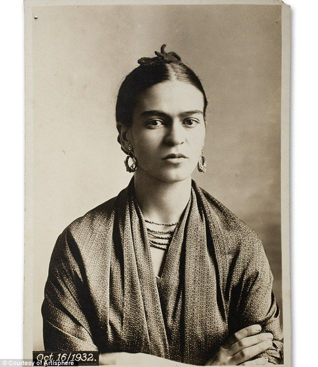 Smoking a cigarette and dressed down in slacks: Intimate photos show the private life of artist Frida Kahlo
