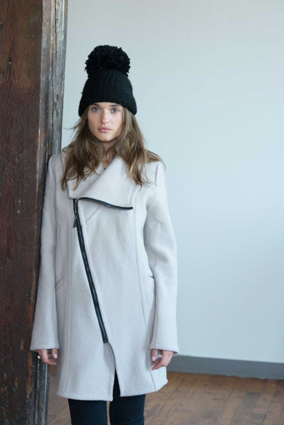 def09ec9235c A high collar light jacket with an asymmetric zipper. The ultimate  statement piece. The