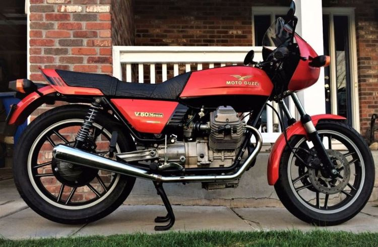 When Moto Guzzi first released the V50 in the late 70s, they were met with a tepid response from an American market that preferred bigger bikes and expected smaller bikes to be cheaper. To help the model stand out, Guzzi released a sportier version in 1980 called the Monza. There were significant changes, the wheelbase was lengthened slightly, the forks were upgraded, the mufflers were angled steeper to increase cornering clearance, clipons were installed and a small fairing helped with wind man