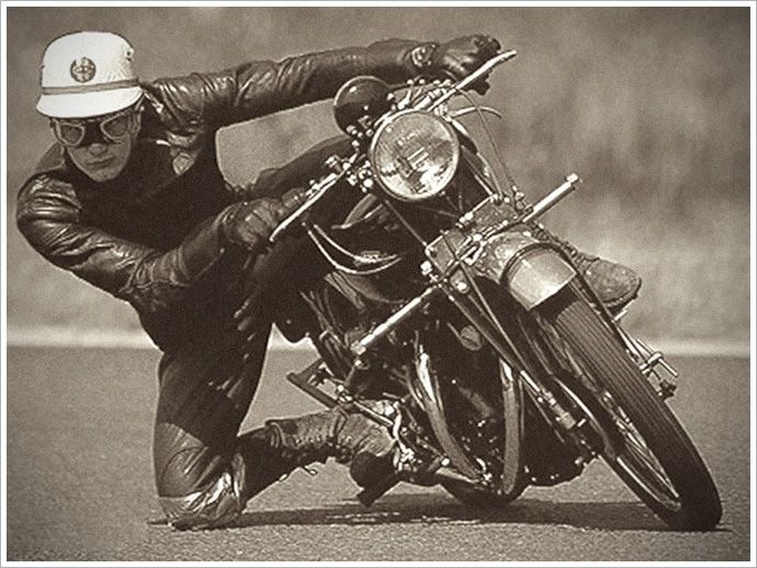 GP racer John Surtees getting his knee down on a Vincent Black Lightning in the '50s