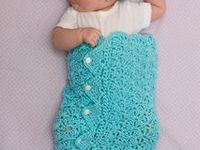 Cozies, Wraps, Buntings, Snuggle Sacks, Sleep Sacks, Sleeping Bags, Swaddlers, Cuddlers, Kicking Sacks, Bubbles, Pods, Baskets, Bowls,  Etc.  And a couple of knit patterns for inspiration.