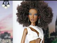 African-American dolls styled in the style of Barbie and a new style Barbie-type.